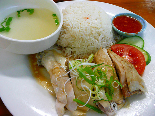 Hainanese chicken rice (the slick rice has been cooked in chicken fats ...